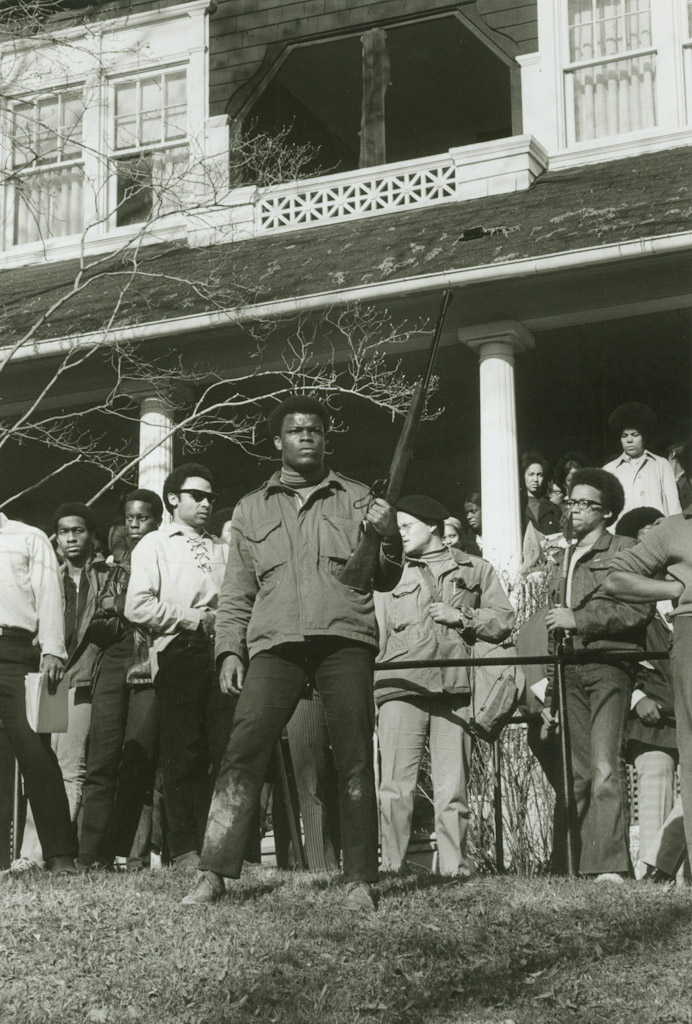 Members of Afro-American Society standing in front of 320 Wait Ave after the end of the takeover; 4/20/69. Copyright held by Cornell University